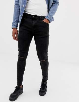 Bershka super skinny jeans in black acid wash with knee rips