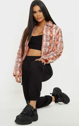 PrettyLittleThing Orange Snake Peach Skin Puffer