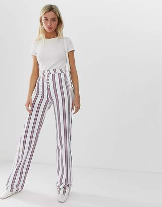 Asos Design DESIGN Full length flare jeans in stripe with exposed fly detail