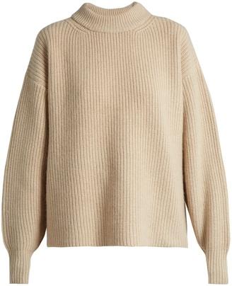 The Row Delia boyfriend knit sweater