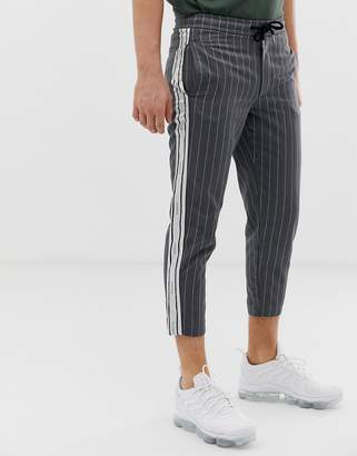 SikSilk cropped pants in gray pinstripe with side stripe