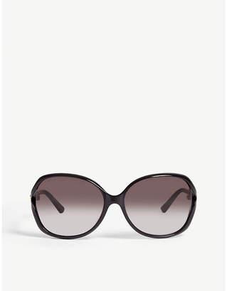 Gucci GG0076S black round sunglasses