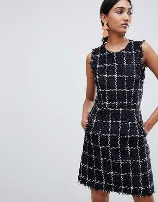 Warehouse shift dress with raw edge in black tweed