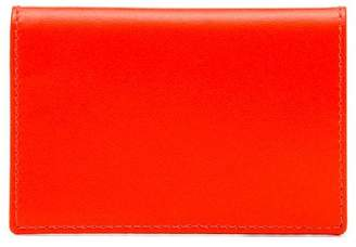 Comme des Garcons fluorescent orange leather wallet