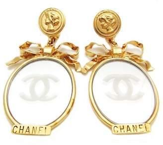 Chanel CC Logo Gold Tone Metal Mirror Medal Ribbon Dangle Earrings