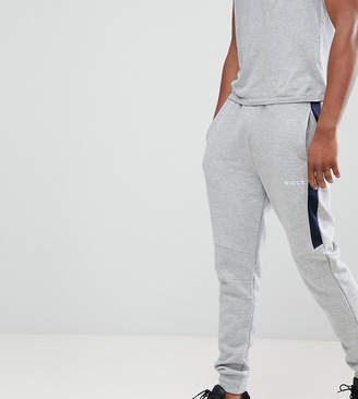 Nicce London bronco skinny joggers with side stripe exclusive to ASOS
