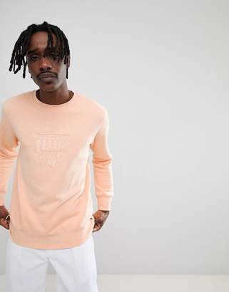 HUF sport sweatshirt with embroidered chest logo in peach