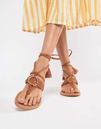 Asos DESIGN Fletcher tie leg with ring detail sandals