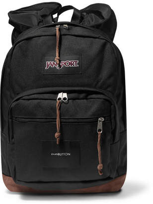 JanSport Pushbutton Ruffled Shell And Suede-trimmed Canvas Backpack - Black