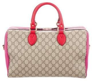 Gucci GG Supreme Medium Top Handle Bag