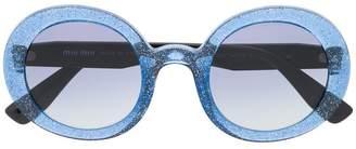 c3d1a4478e32 Miu Miu Blue Women s Sunglasses - ShopStyle