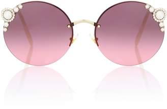 Miu Miu Maniere round sunglasses