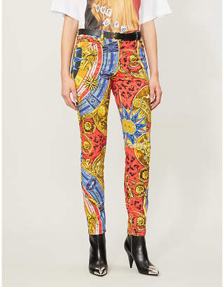 Moschino Baroque-pattern tapered mid-rise jeans