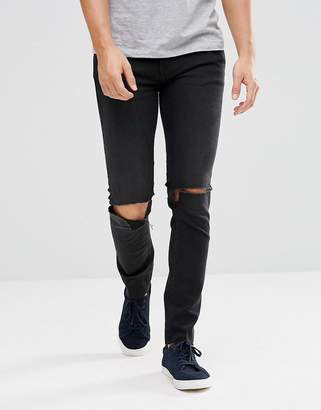 Cheap Monday Tight Black Skinny Jeans with Knee Rip