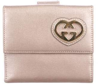 3038587d92b2f6 Gucci Interlocking GG Heart Wallet