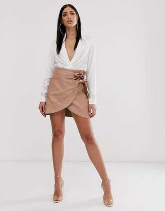 Parallel Lines leather look wrap front mini skirt with bow detail in tan