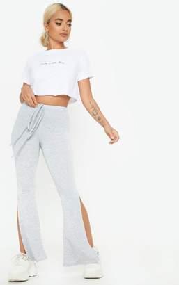 PrettyLittleThing Petite Grey Jersey Tie Waist Split Flare Trousers