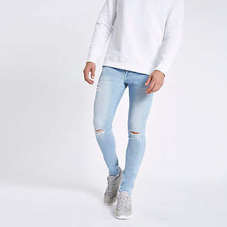 River Island Light blue ripped skinny spray on jeans