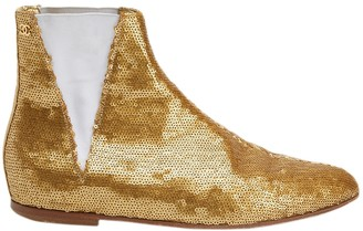 Chanel Gold Glitter Boots