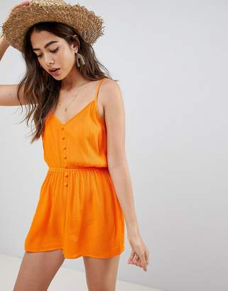 Asos Design DESIGN Playsuit In Crinkle With Button Front