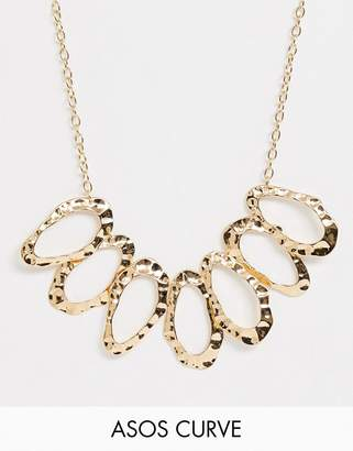 Asos DESIGN Curve statement necklace with hammered open shapes in gold