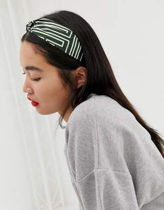 Asos Design DESIGN headband with twist front in geo monogram print in green