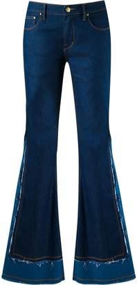 Amapô frayed overlay flared jeans