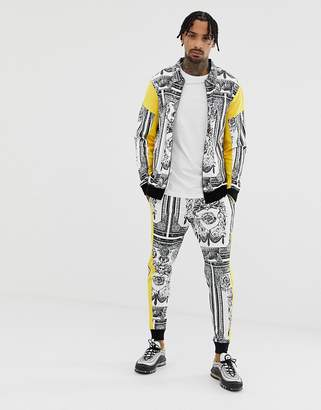 Asos DESIGN tracksuit harrington jersey jacket / skinny sweatpants tracksuit in baroque print and side stripe