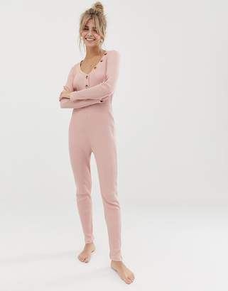 Asos DESIGN rib fitted high waisted jumpsuit with tortoishell buttons