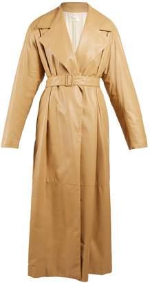 Belted oversized leather coat