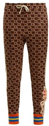 Gucci Gg Jacquard Mid Rise Jersey Trousers - Womens - Brown Multi