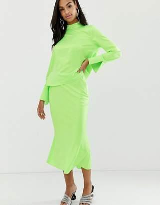 Asos Design DESIGN bias cut satin slip midi skirt in neon