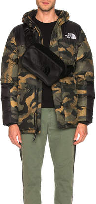 The North Face Deptford Down Jacket in Burnt Olive Green Waxed Camo Print | FWRD