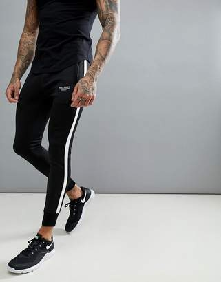 Muscle Monkey Skinny Joggers In Black With Stripe