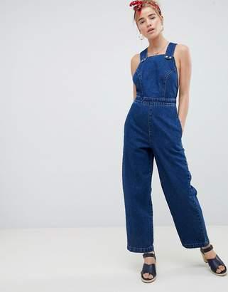 8548ca27e2f Asos Design DESIGN denim cross back jumpsuit in blue with popper detail