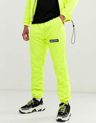 Night Addict neon trackpants