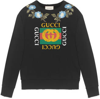 Cotton sweatshirt with Gucci print and flowers $1,200 thestylecure.com