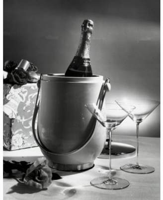 Posterazzi Champagne bottle in an ice bucket with two empty martini glasses beside it Canvas Art - (24 x 36)
