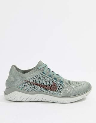 Nike Running Free Run Flyknit Trainers In Grey And Pink