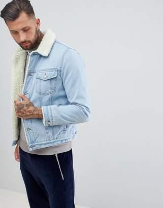 Asos DESIGN Fleece Lined Denim Jacket In Blue Wash