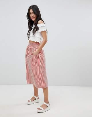 Asos DESIGN cotton midi skirt with button front in stripe