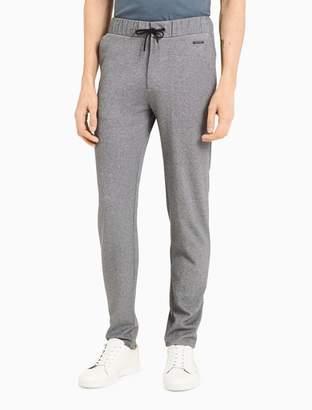 Calvin Klein raw-edge interlock pique pants