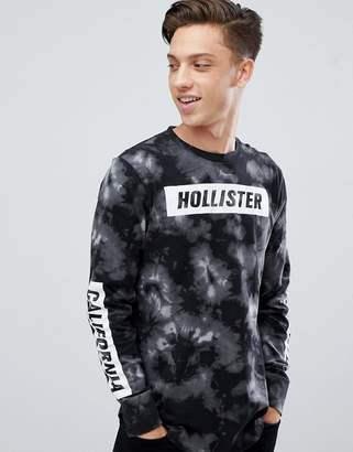 Hollister acid wash long sleeve top front and sleeve logo in black
