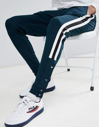 Asos DESIGN Skinny Retro Track Joggers In Green With Side Stripe And Popper Hem