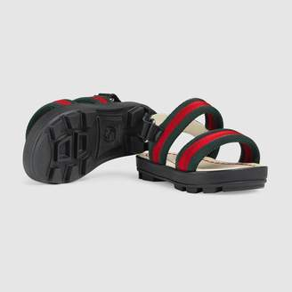 70c211881 at Gucci · Gucci Toddler leather and Web sandal