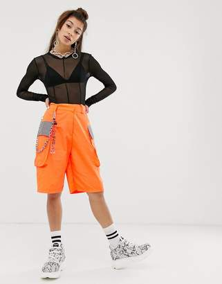 Jaded London longline utility shorts in neon orange with reflective detail