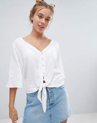 Bershka button down knot front blouse in white