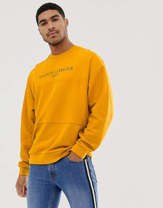 76724158da672d Asos Design DESIGN oversized sweatshirt withreverse loopback panel with  text print in yellow
