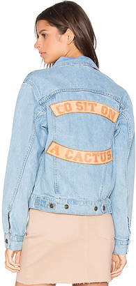 Understated Leather Go Sit on a Cactus Denim Jacket.