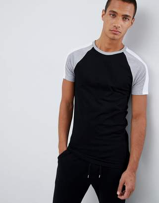 Asos DESIGN muscle fit t-shirt with contrast split sleeves in black and curved hem